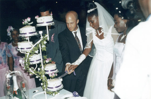 Greg And Joanitha Cutting The Wedding Cake Bukoba