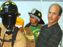 """Greg and Joachim with fireman, Children's Museum"", Denver, Colorado, 2007"