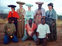 Peace Corps Volunteers in Herero dress with language trainers, Windhoek, Namibia, 1994