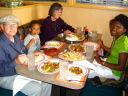 """Joanitha, Joachim and grandparents at a Chinese restaurant"", Taos, New Mexico, 2009"