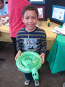 Joachim with balloon snake, Fort Collins, Colorado, 2011