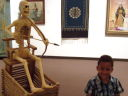 Joachim with a skeleton in a museum, Albuquerque, New Mexico, 2009