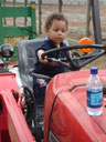 """Joachim on a tractor, Lee Martinez Park"", Fort Collins, Colorado, 2007"